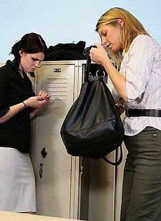 Девушка шлепает другую девушка указкой по попке