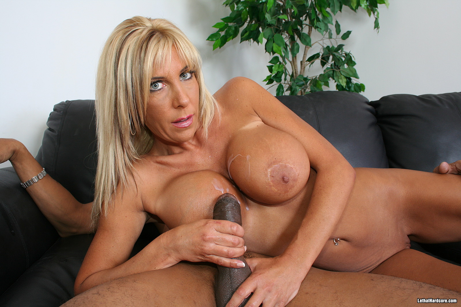 Posh misty vonage dominated by black cock in front of son